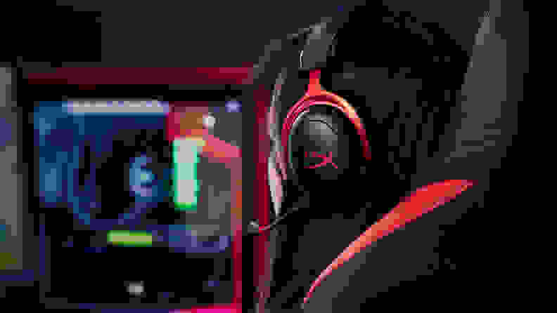 An image of the HyperX Cloud II wireless headset being worn while playing a game.