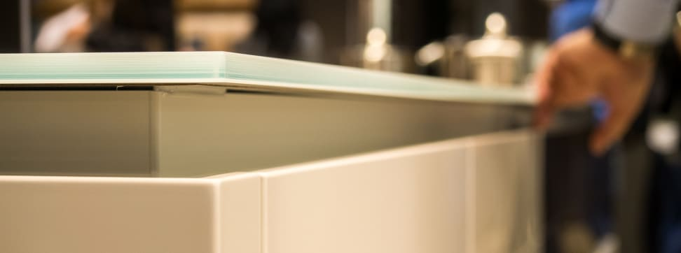 Tempered glass is just one of several alternatives to granite for countertops.