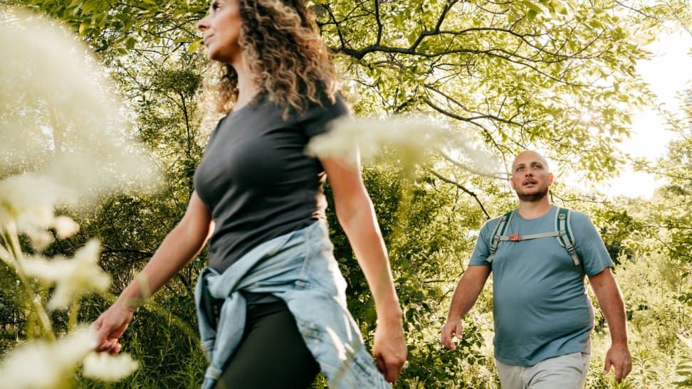 woman and man on an outdoor hike
