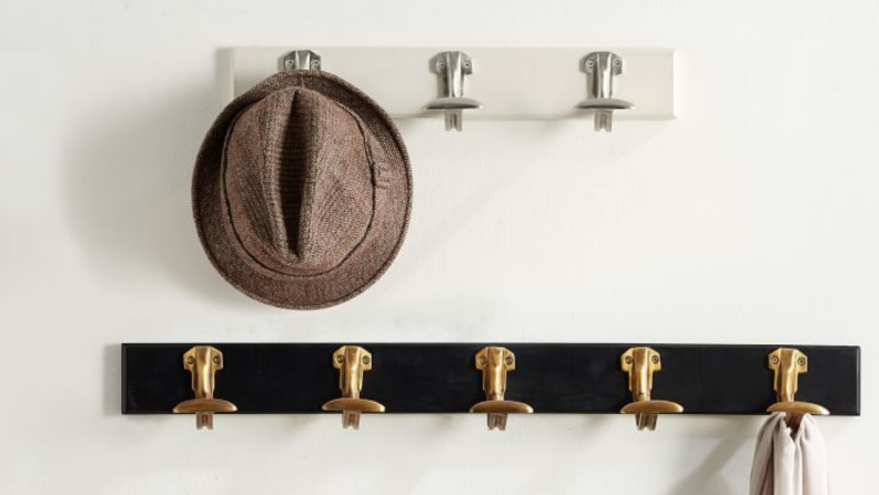 A wall hook rack is essential for hanging up coats that you wear daily, making it easy to grab on your way out.
