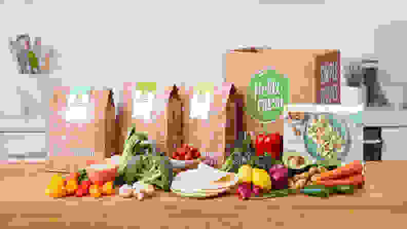 The HelloFresh meal kit contents laid out on a table.
