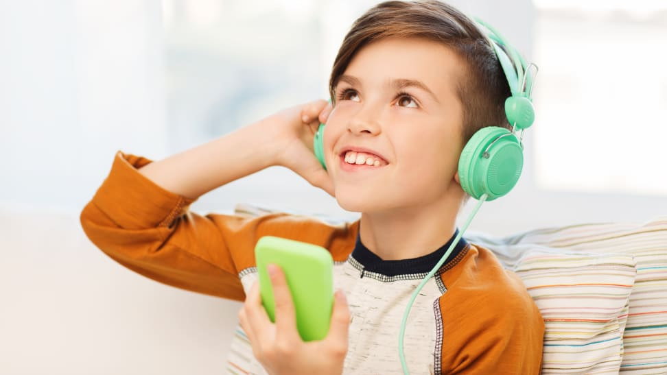 Boy listening to podcast on headphones