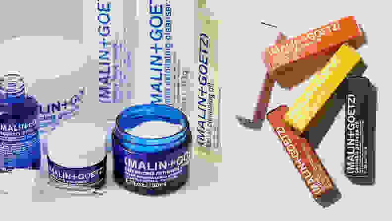 a bunch of blue and white skincare products on a bathroom counter next to rainbow colored packages products