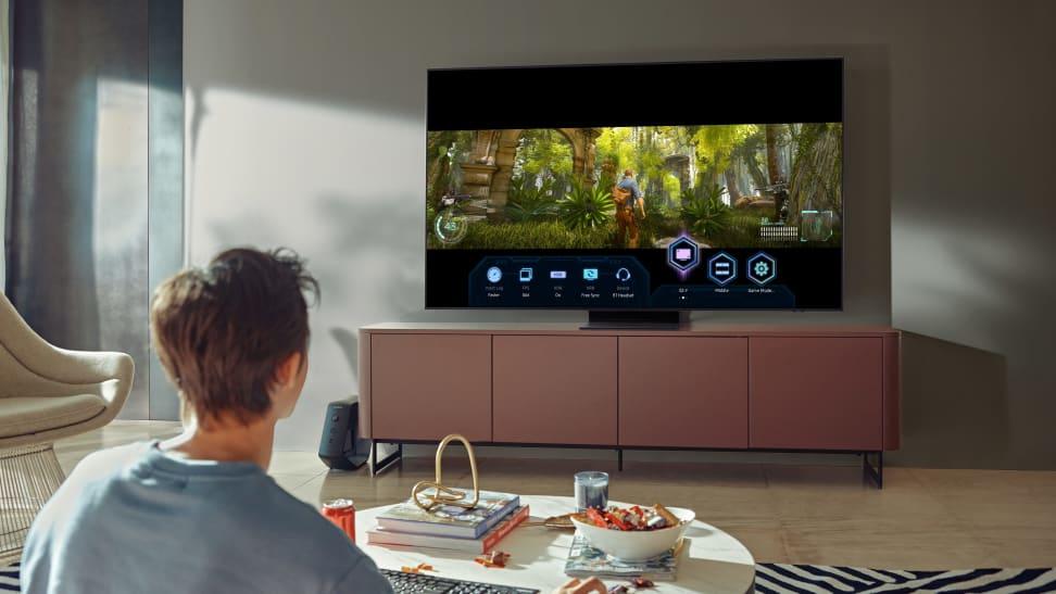 Man sitting in living room watching Samsung TV.