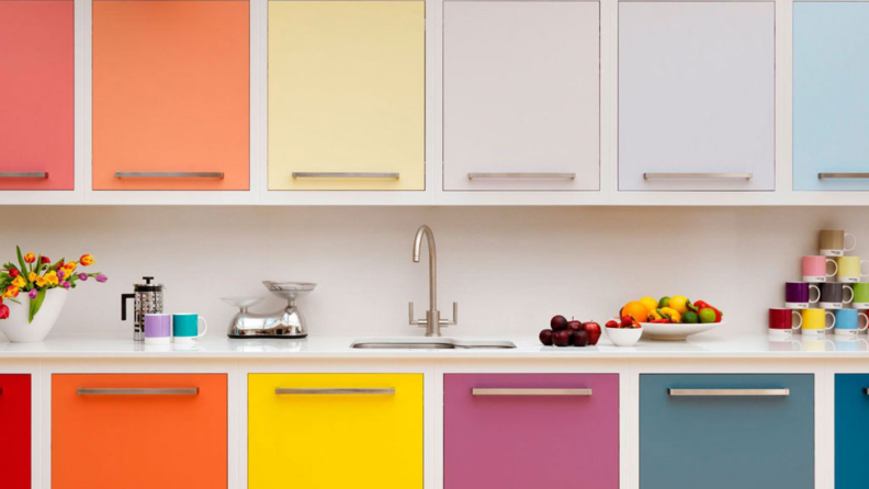 Multicolored vinyl cabinet liner in a kitchen.