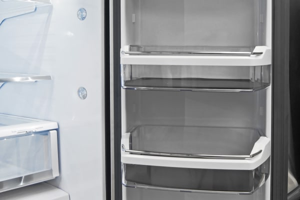 Gallon-sized buckets and a drop down tray make the GE Cafe CFE28TSHSS's right fridge door unexpectedly versatile.