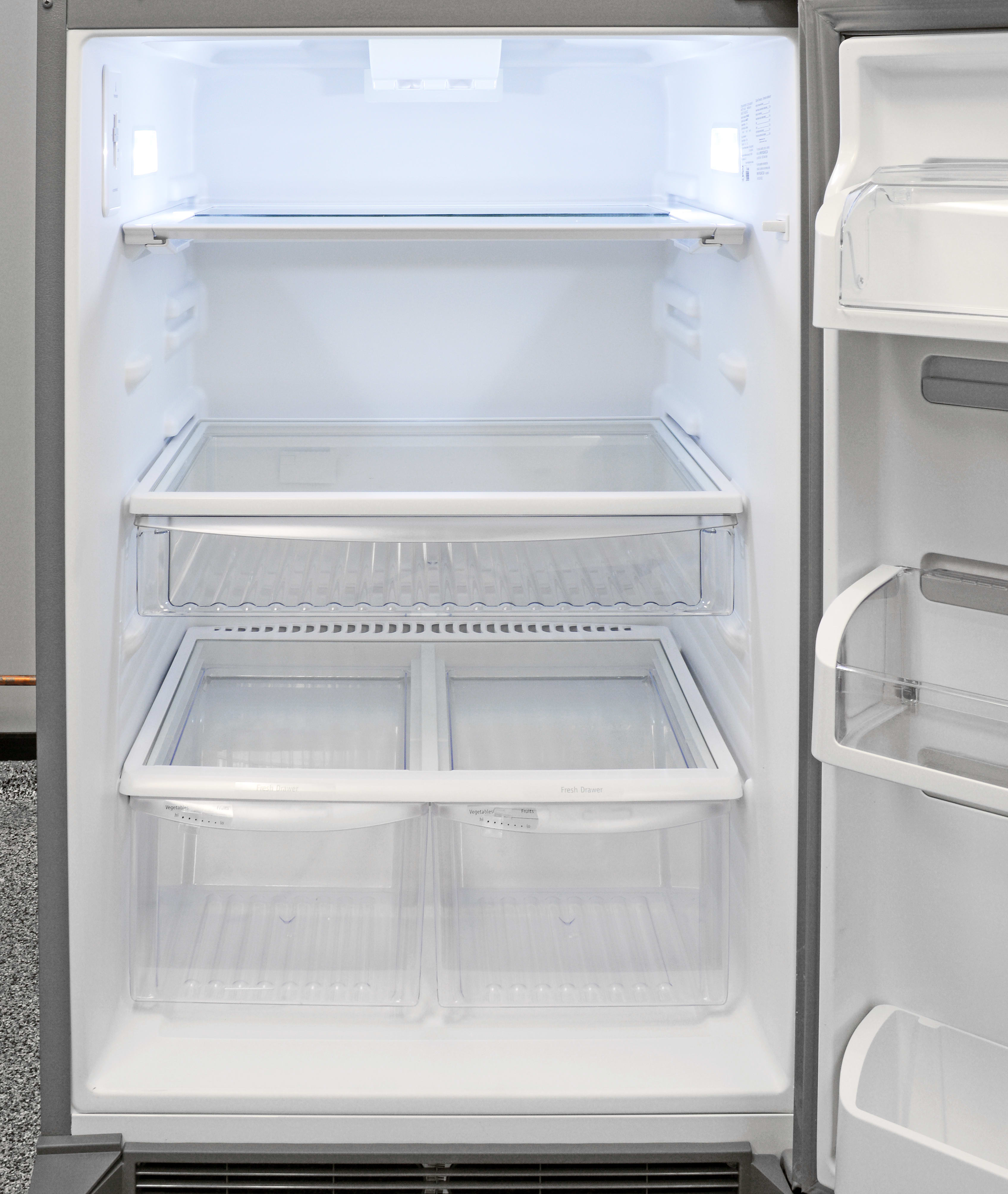 The Frigidaire Gallery FGHT2046QF's top shelf features a retractable front half for storing tall items.
