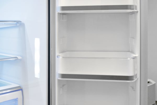 The Samsung RF28HMEDBSR's right door features three adjustable shelves, all of which can hold two gallon-sized containers.