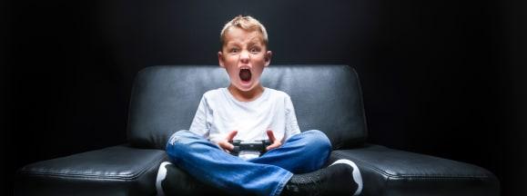 Kid playing video game esrb hero