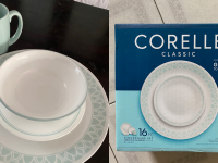 On left, four piece white and pastel blue set of Corelle dishes. On right, Corelle original packaging for 16-piece dinnerware set.