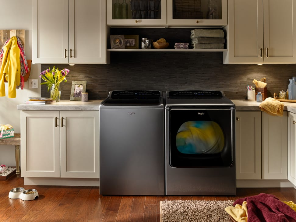 Whirlpool smart top load laundry pair in a laundry room