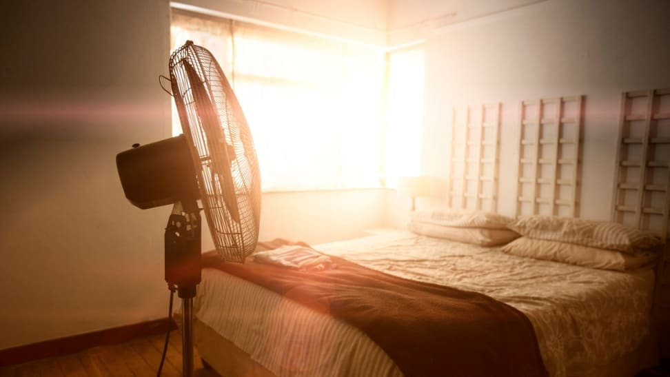 A fan in a sunlit bedroom