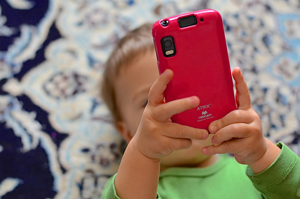 Toddler holding a smartphone
