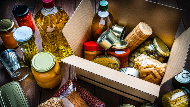 A box filled with non-perishable food items for donation.