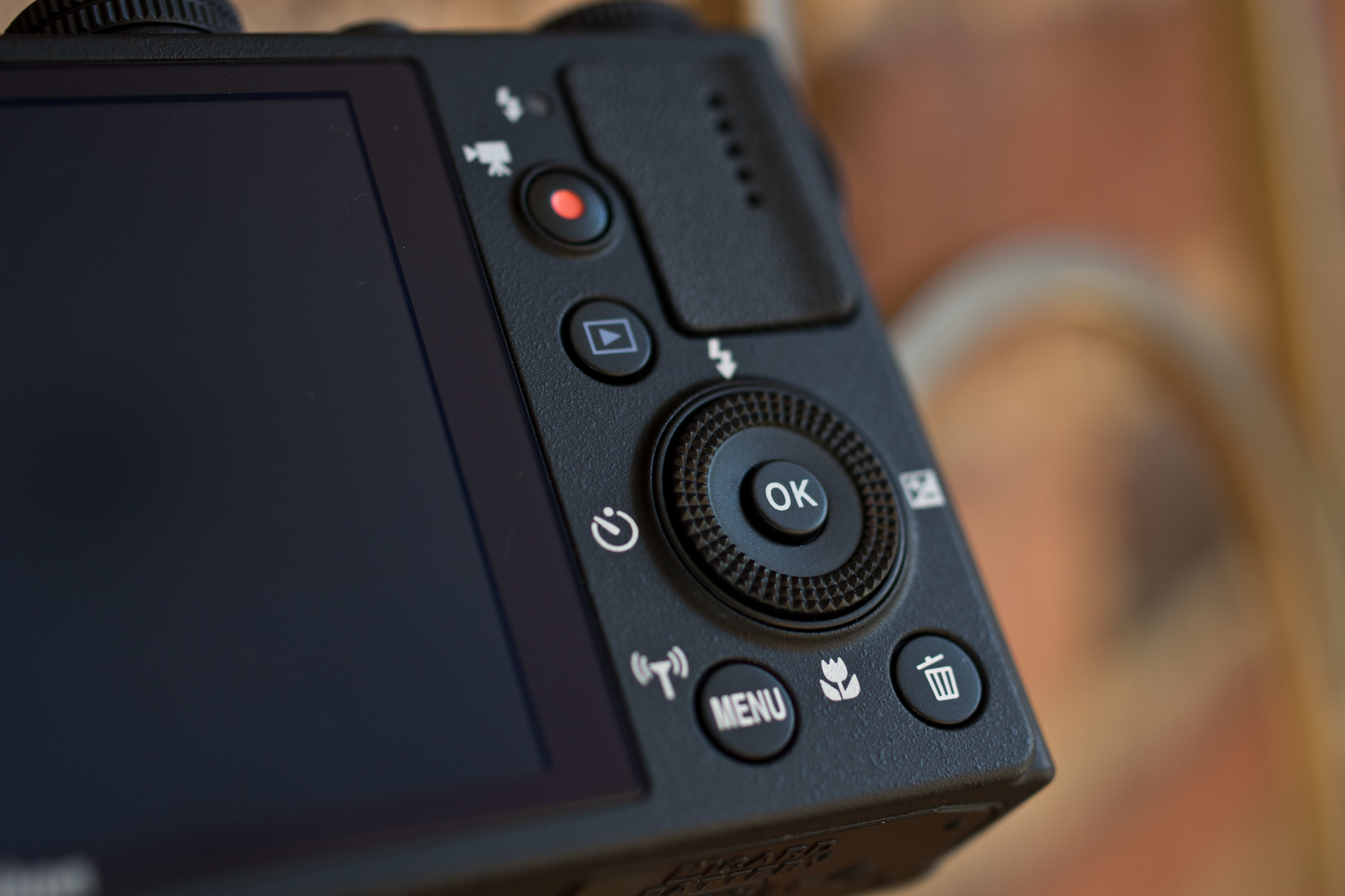A photograph of the Nikon Coolpix P340's rear controls.