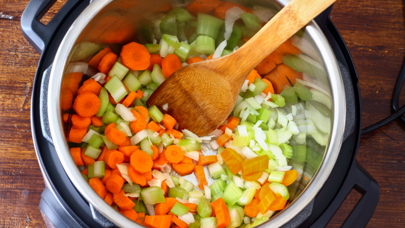 An above view of diced vegetables being cooked in an Instant Pot