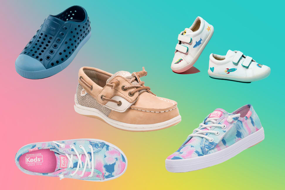 Lots of kids shoes on a tie-dye background.