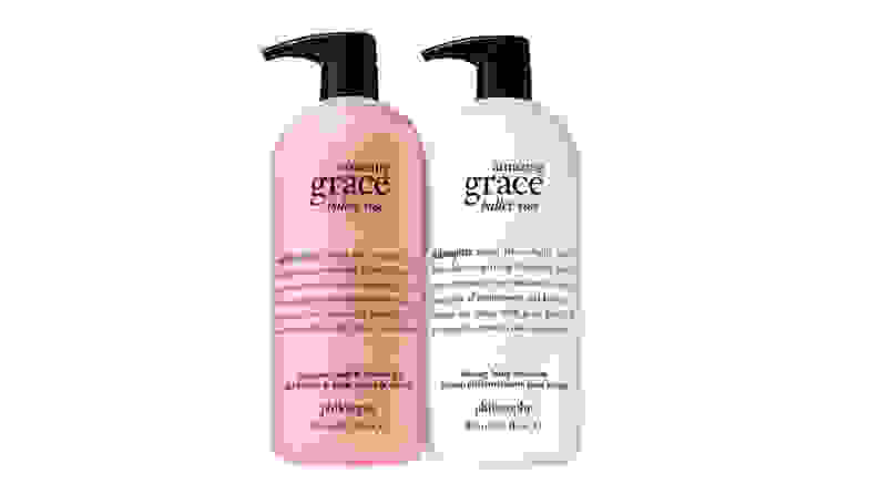 bottles of body wash in pink and white on white bckground