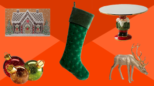 Holiday decorations on a red background, including ornaments, a stocking, a doormat, a dear and a cake plate