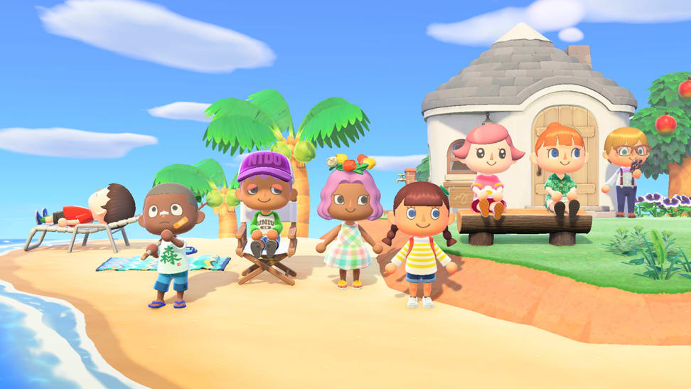 A group of friends stand on a beach in Animal Crossing: New Horizons.