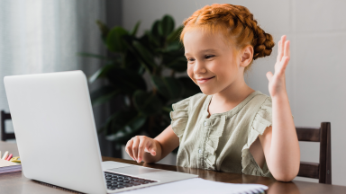 Girl waving to computer