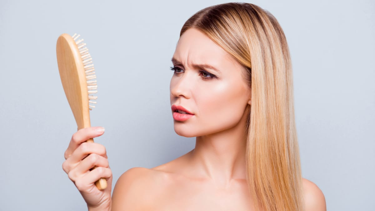 Your hairbrush is full of bacteria and germs—here's how to clean it