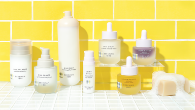 skincare products in front of yellow brick wall