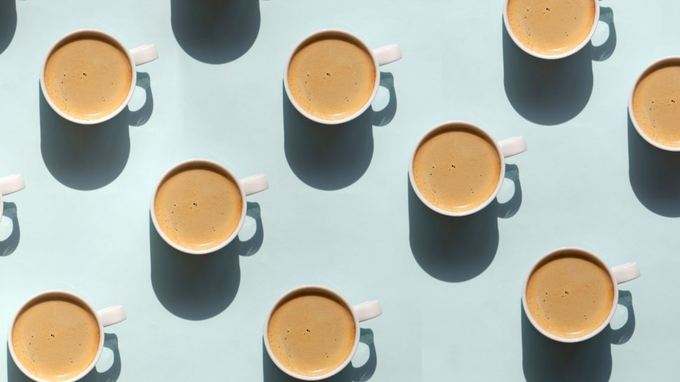 Cups of coffee arranged in a pattern across a light blue background.