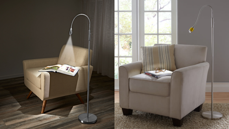 A floor lamp lights the surface of a. chair in a dark room.