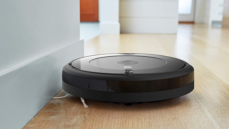 The  iRobot Roomba 692 cleaning a wooden floor.
