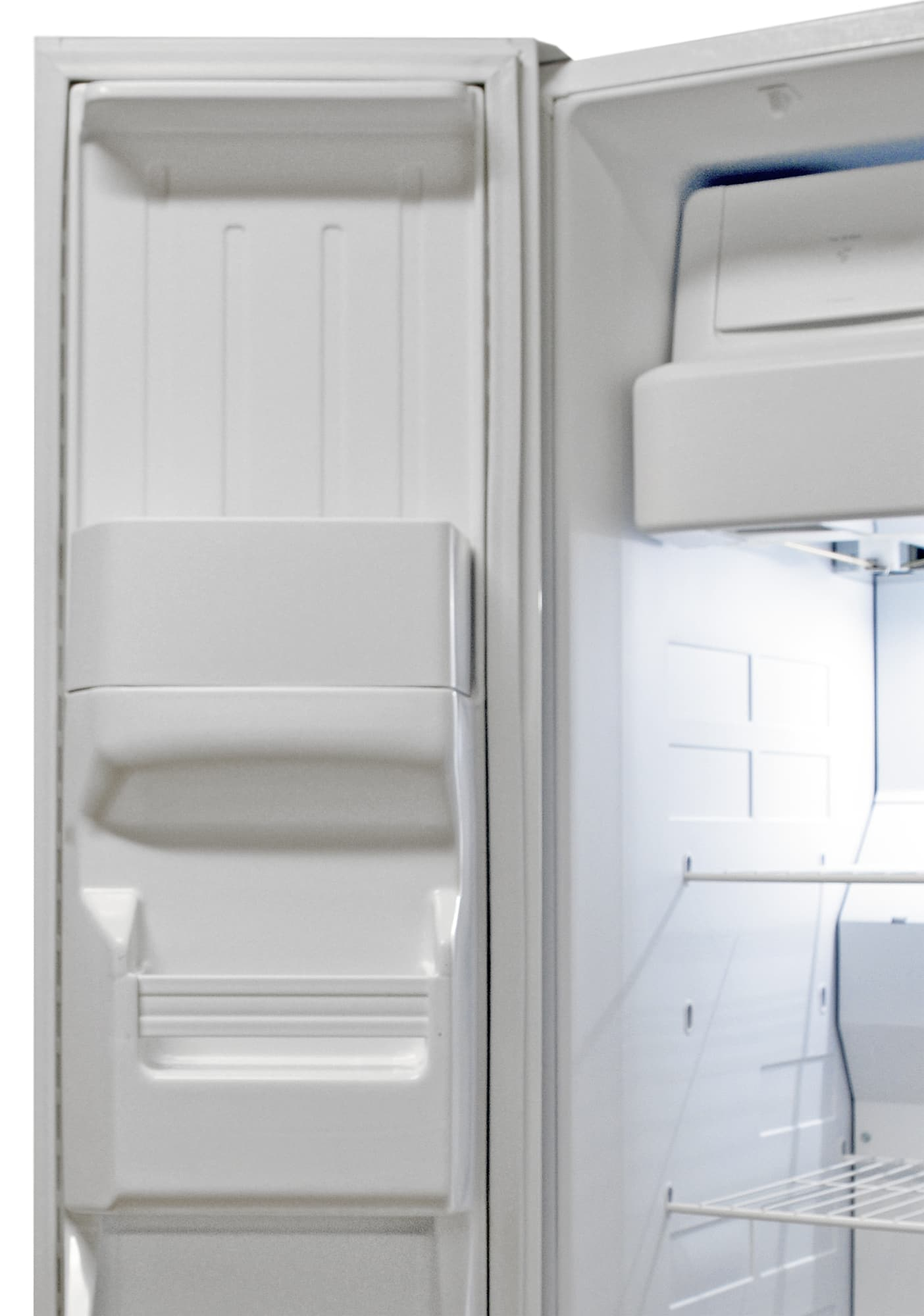 Most of the Kenmore 51122's freezer door lacks storage due to the large ice dispenser.