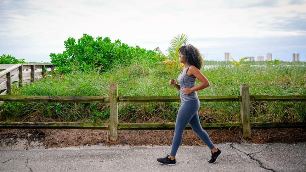 A woman power walking outside.
