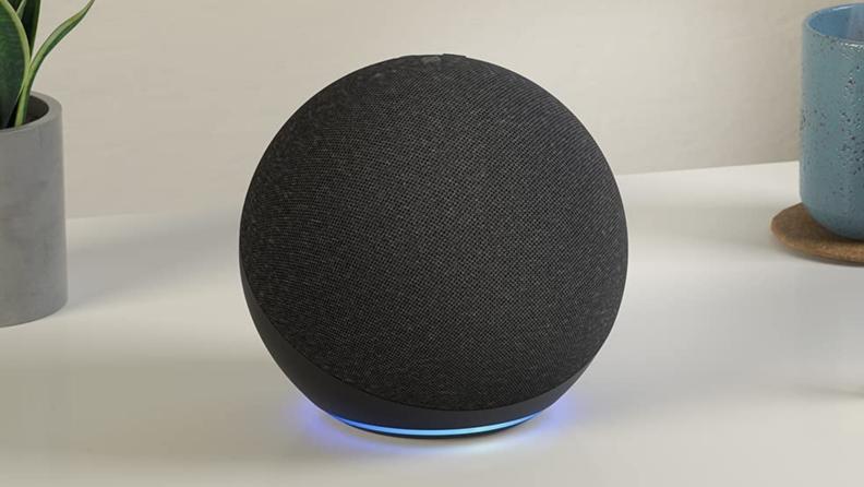 A black Amazon Echo sits on a counter.