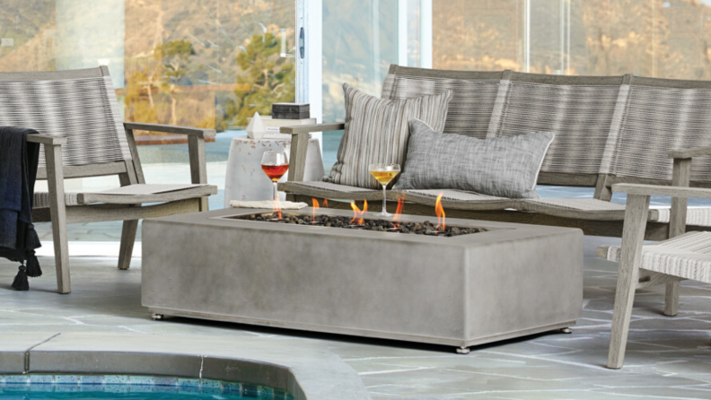 For an upscale fire feature, try Arhaus' rectangular, light gray concrete, outdoor fire table. It can be yours for about a grand.