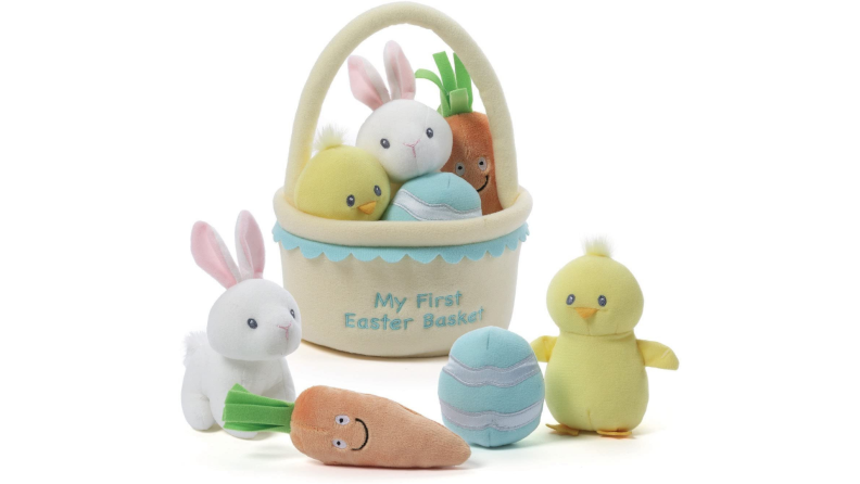 A plush Easter basket with a stuffed toy rabbit, duckling, Easter egg and carrot.