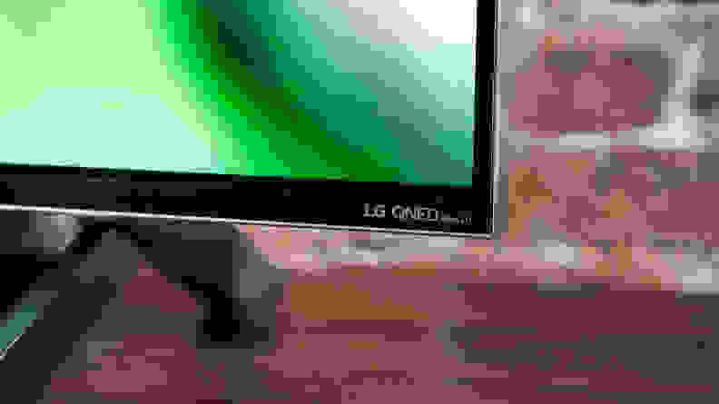 A close-up of the LG logo on the front of the LG QNED99 8K TV