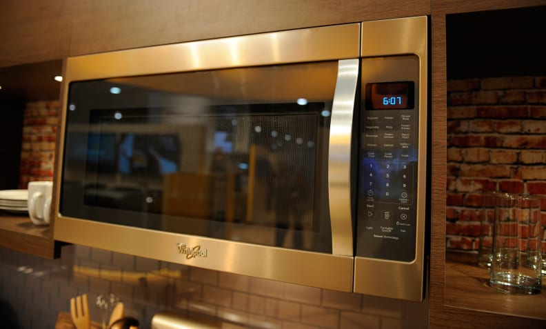 A Sunset Bronze microwave adds the finishing touch to a complete kitchen suite.