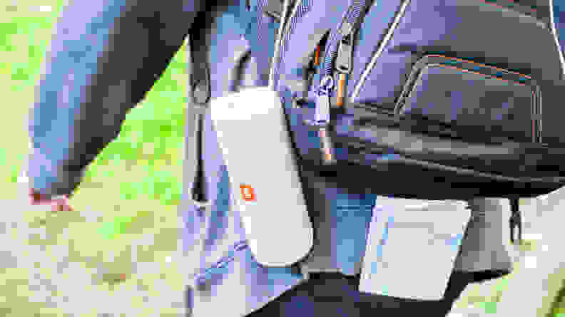 JBL speaker attached to a man with a backpack