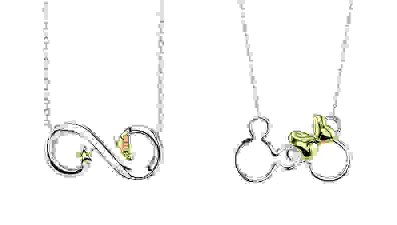 two silver/gold necklaces on white background