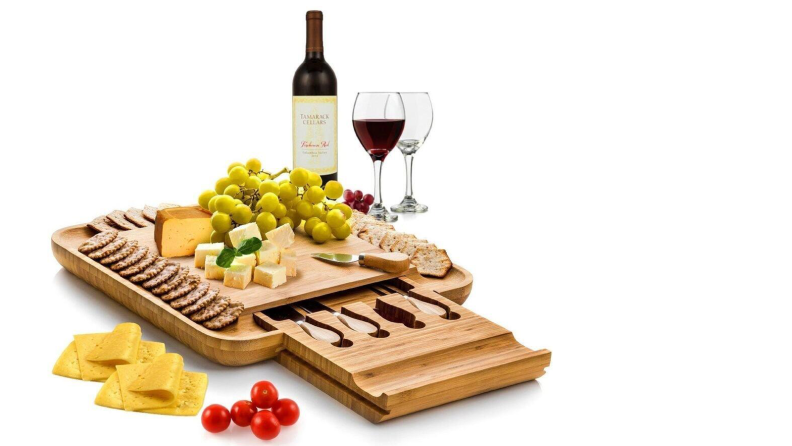 Cheeseboard with snacks and wine