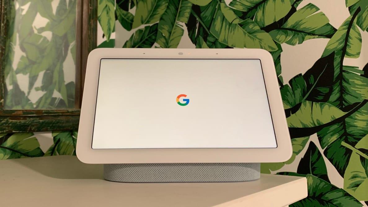 A Google Nest Hub (second-gen) smart display is shown on a white dresser.