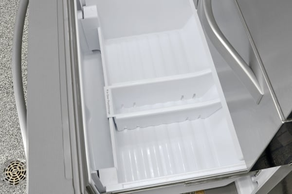 ...and a lower, deeper drawer, perfect for storing lots of meat. The Whirlpool WRV986FDEM also has a frozen pizza caddie just inside the door.