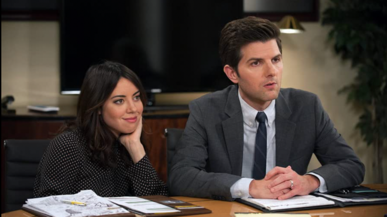A still from Parks & Rec featuring April Ludgate and Ben Wyatt.