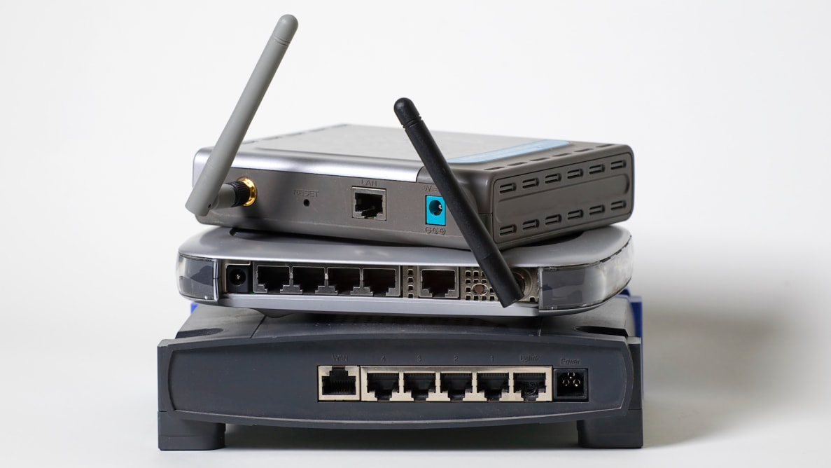 A number of wireless routers, stacked on top of one another.