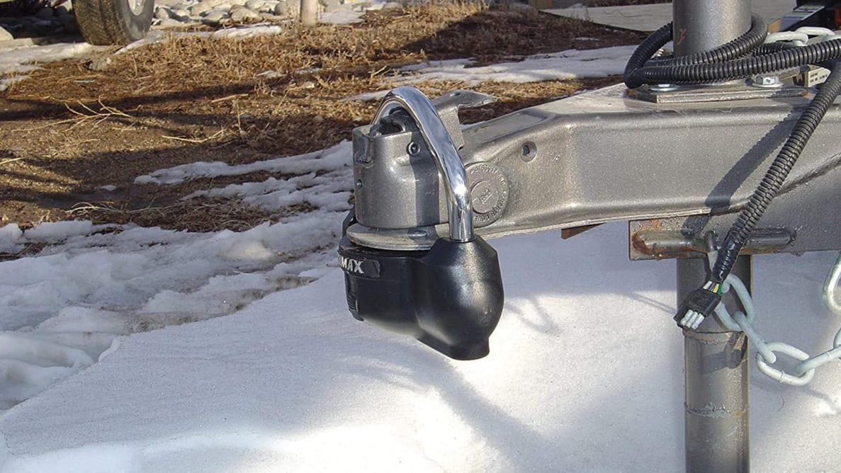 RV hitch lock against a backdrop of snow.
