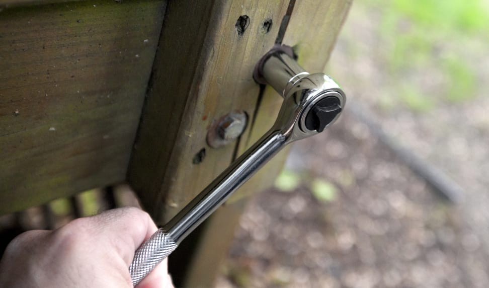Tightening a lag bolt with a ratchet and socket