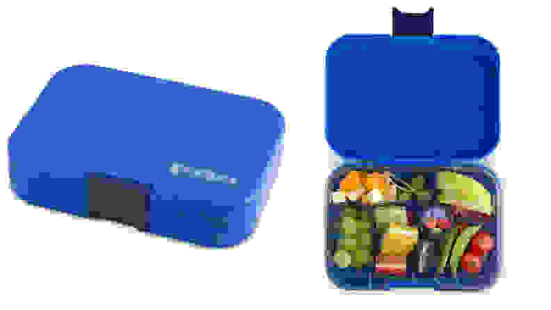 A blue reusable lunchbox shown closed and open with food inside.