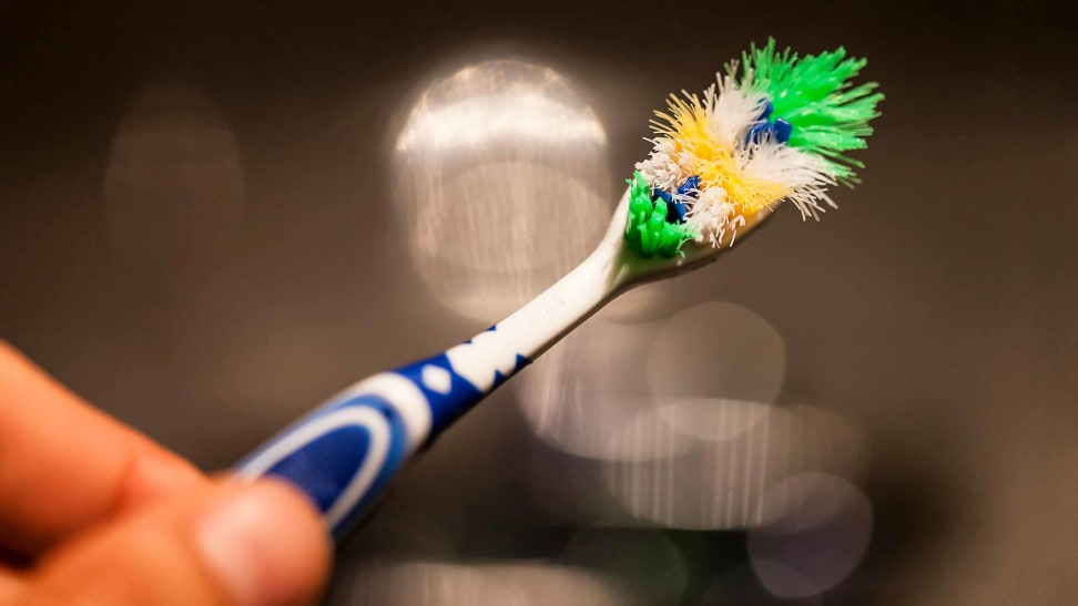 An old toothbrush that needs to be replaced