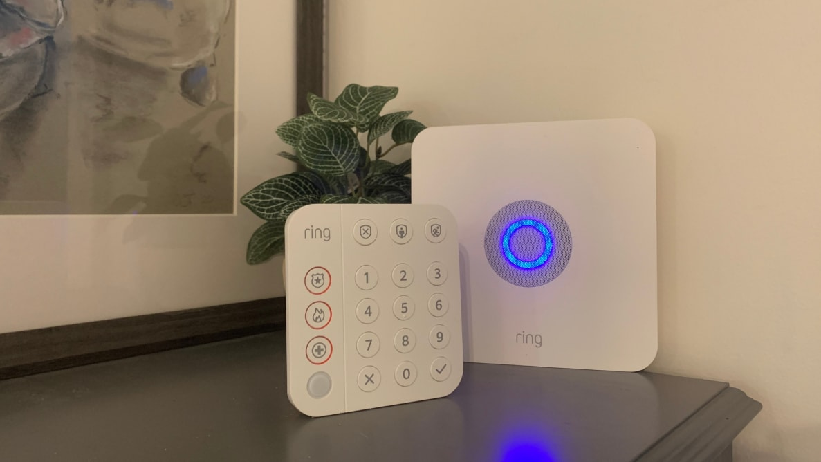 The Ring Alarm System keypad and home base station sit on a grey stand.