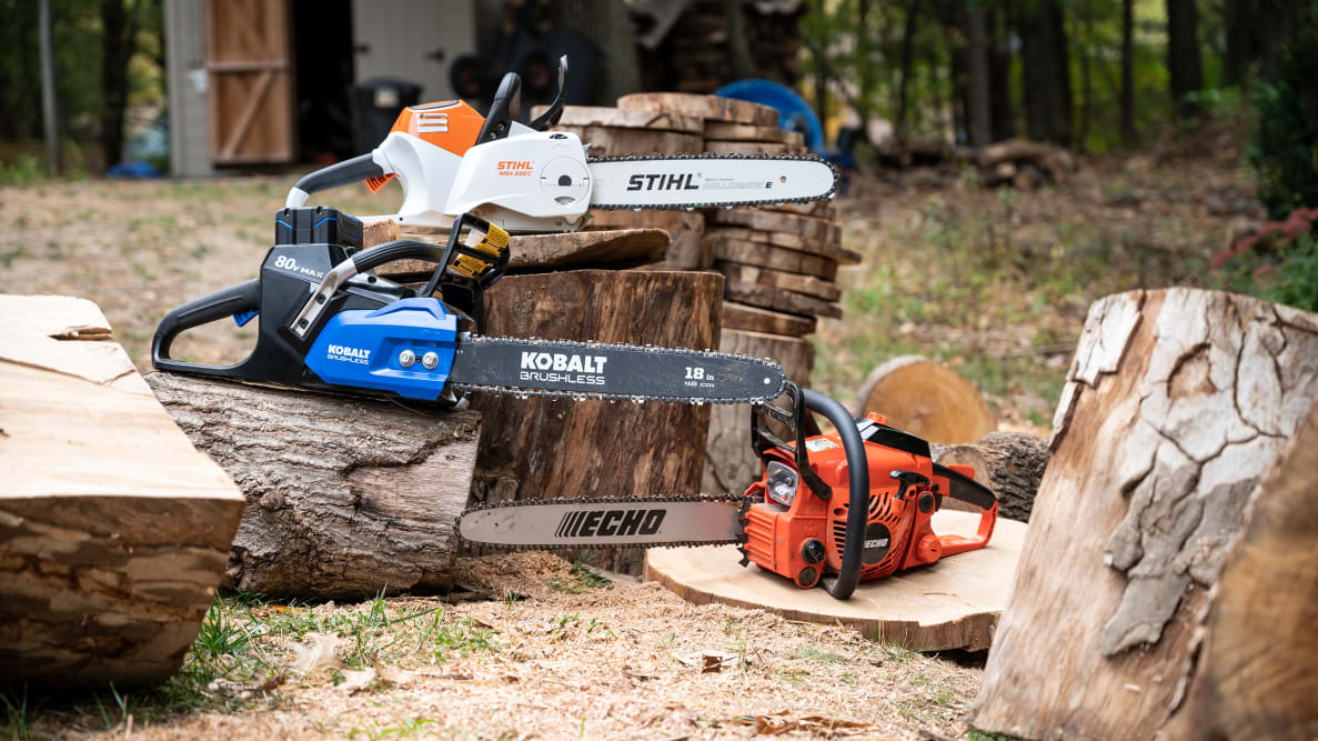 Several chainsaws displayed outdoors.